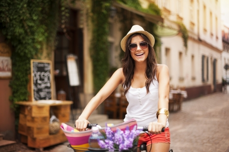 woman: Beautiful woman riding on bike Stock Photo