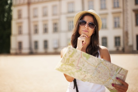 destiny: Tourist girl with map wondering where she should go