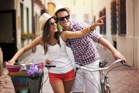 Happy couple with bikes in the city Stock Photo