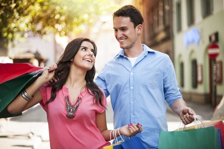 Young couple enjoying shopping together  photo