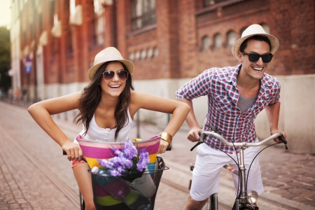 Couple riding bicycles in the city photo
