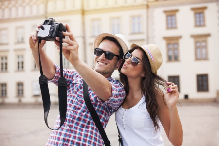 digital camera: Happy tourists taking photo of themselves