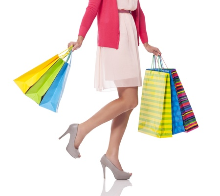 Carrying shopping bags, low section Stock Photo - 21032522