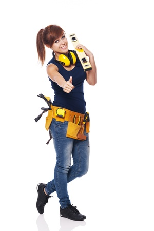 female construction worker: Young female construction worker showing OK sign