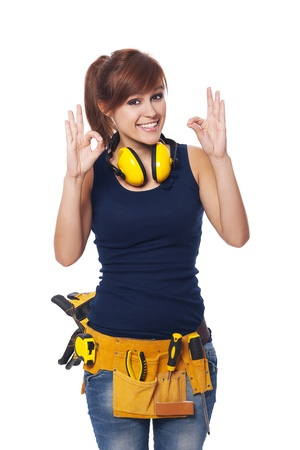 female construction worker: Happy young female construction worker gesturing OK sign