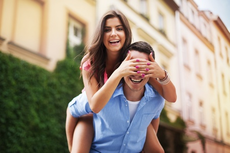 Beautiful woman spending funny time with her boyfriend  photo
