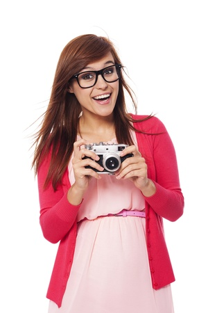 Excited woman holding in hands old camera Stock Photo - 21534435