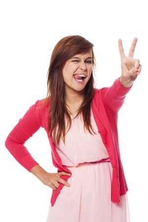 Funny young woman showing victory sign  photo