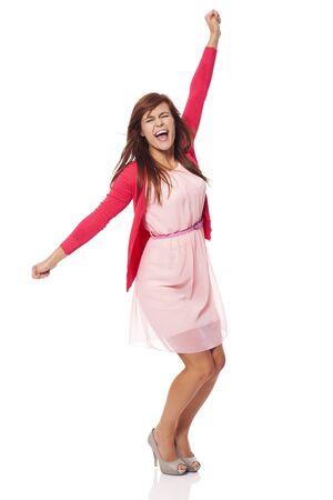 cheering people: Young beautiful woman screaming of joy  Stock Photo