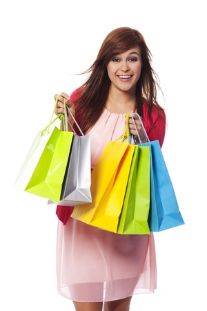 Fashionable young woman with shopping bags photo