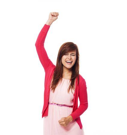Cheering beautiful young woman  photo