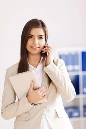 Young businesswoman with digital tablet and mobile phone  photo
