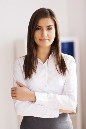 Portrait of beautiful young businesswoman at office photo