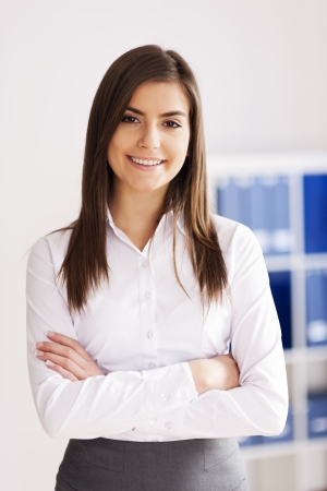 female office worker: Portrait of smiling young businesswoman at office