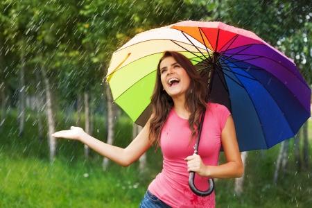 woman umbrella: Natural female beauty in autumn rain Stock Photo
