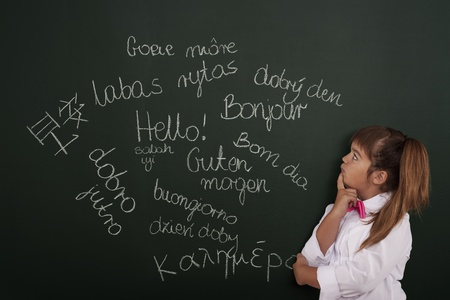 child education: Small girl thinking about foreign phrases