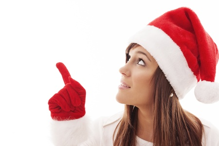 Christmas woman pointing at copy space Stock Photo