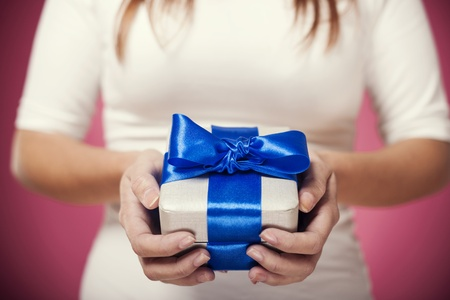 blue gift box: Woman hands holding gift Stock Photo
