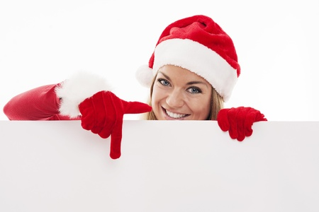 Santa woman pointing at blank whiteboard