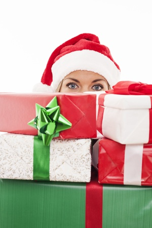 Woman holding christmas present in front of face photo