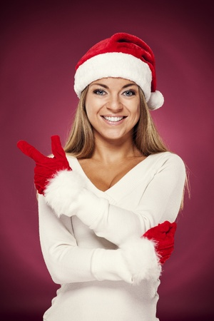 Santa woman pointing at copyspace photo