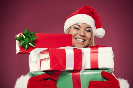 Happy woman holding christmas presents photo