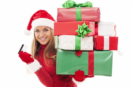 mrs santa claus: Beautiful woman holding christmas presents and credit card Stock Photo