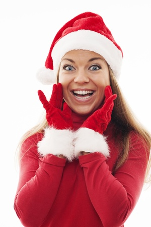 Young woman with santa hat and gloves looking excited photo