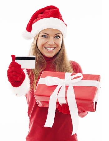 Happy woman with red gift and credit card photo