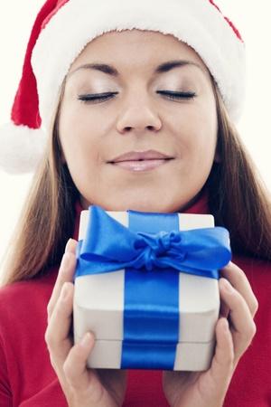 Christmas time - Beautiful woman holding present photo