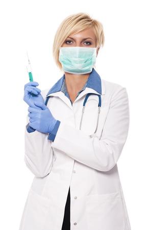 Blonde female doctor holding syringe photo