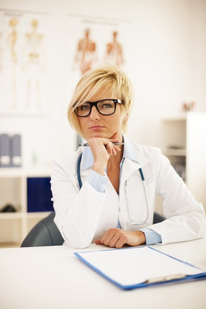 Portrait of beautiful blonde female doctor   photo