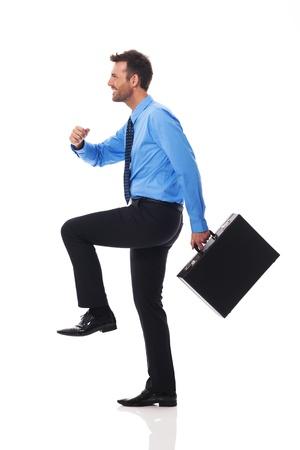 Self confident businessman climbing for success  photo
