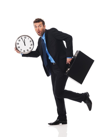 running late: Businessman running late for a meeting Stock Photo