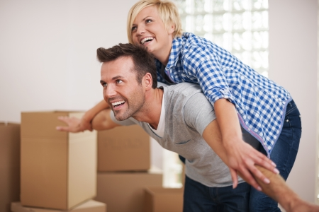 Man carrying wife on his back Stock Photo - 22025500