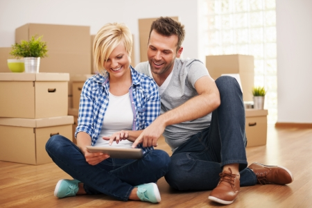 house moving: Smiling couple buying new furniture for their home   Stock Photo