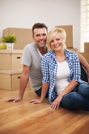 Portrait of attractive couple in new house photo