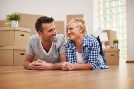 Couple taking a break from moving house photo