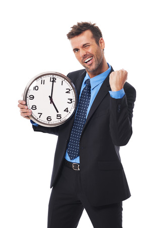 oclock: Cheerful businessman finishing his job today Stock Photo