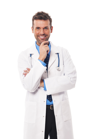 Portrait of confident handsome doctor photo