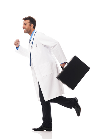 Doctor running urgency to patient photo