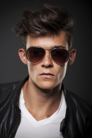Portrait of male model wearing sunglasses  photo
