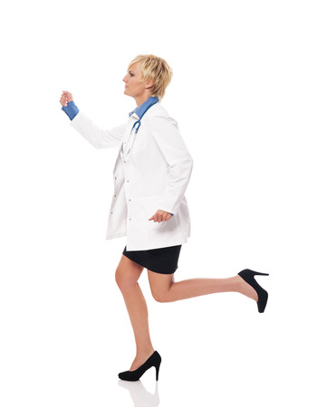 Female doctor running for her patients photo