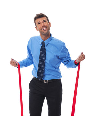 clutches: Business man trying free themselves from clutches of corporate