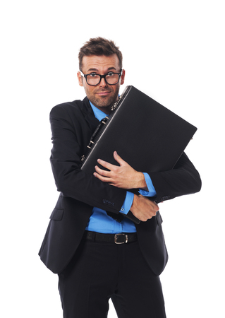 Frightened man firmly clutching his briefcase photo
