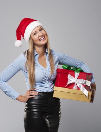 Business Mrs. Claus with stack of christmas gift  photo
