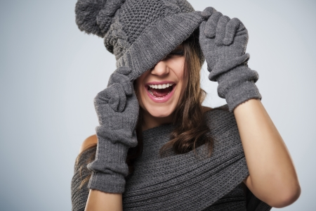 pompon: Young woman have fun with winter clothing Stock Photo