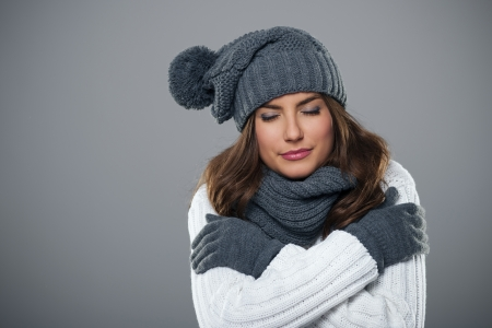 pompon: Young woman shivering during the winter season  Stock Photo