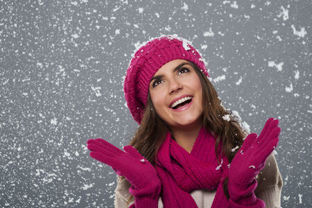Beautiful woman is happy from snow in winter time  photo