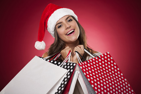 Smiling woman with christmas shopping Stock Photo - 22679443